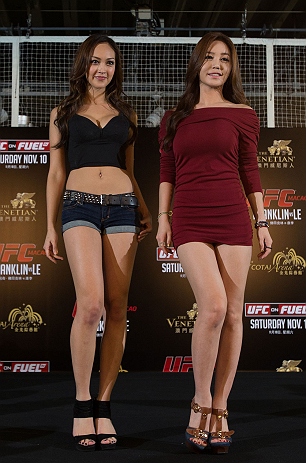 HONG KONG - NOVEMBER 07:  (L-R) UFC Octagon Girls Jessica Cambensy and Ye-Bin Kang pose for photos during a UFC press conference at Harbour City Mall on November 7, 2012 in Hong Kong, Hong Kong.  (Photo by Josh Hedges/Zuffa LLC/Zuffa LLC via Getty Images)