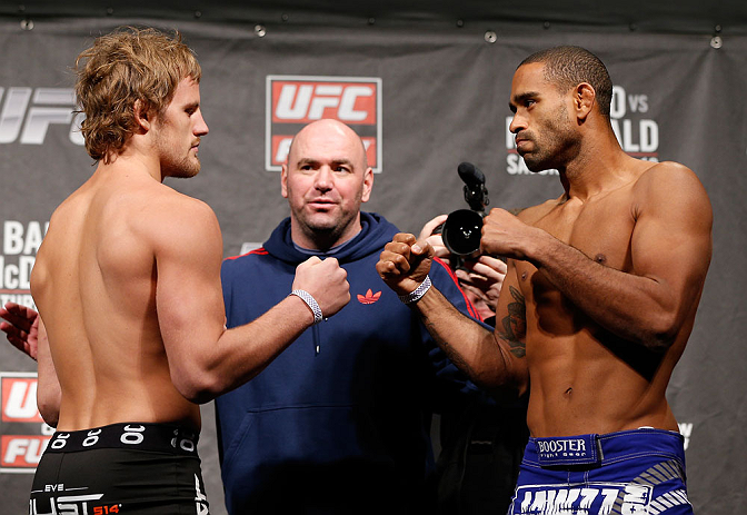 LONDON, ENGLAND - FEBRUARY 15:  (L-R) Opponents Gunnar Nelson and Jorge Santiago face off during the UFC weigh-in on February 15, 2013 at Wembley Arena in London, England.  (Photo by Josh Hedges/Zuffa LLC/Zuffa LLC via Getty Images)