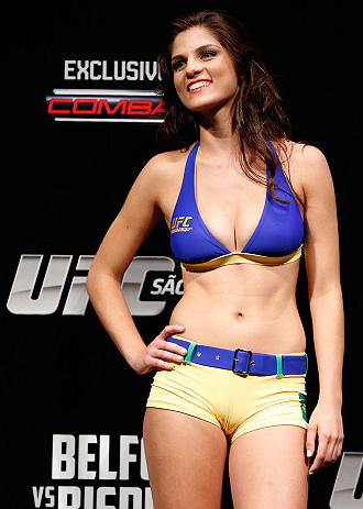SAO PAULO, BRAZIL - JANUARY 18:  UFC Octagon Girl Aline Caroline Franzoi stands on stage during the UFC on FX official weigh-in event on January 18, 2013 at Ibirapuera Gymnasium in Sao Paulo, Brazil. (Photo by Josh Hedges/Zuffa LLC/Zuffa LLC via Getty Images)