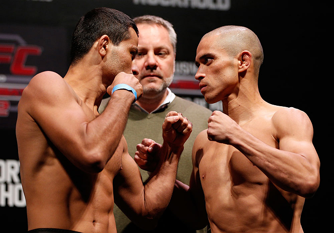 JARAGUA DO SUL, BRAZIL - MAY 17: (L-R) Opponents Jussier Formiga and Chris Cariaso face off during the UFC on FX weigh-in on May 17, 2013 at the Arena Jaragua in Jaragua do Sul, Santa Catarina, Brazil. (Photo by Josh Hedges/Zuffa LLC/Zuffa LLC via Getty Images)