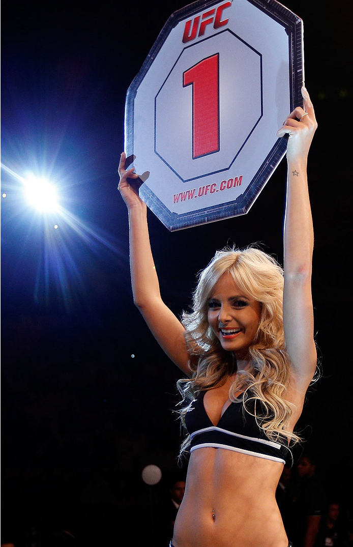 SAO PAULO, BRAZIL - MAY 31: UFC Octagon Girl Jhenny Andrade introduces a round during the UFC Fight Night event at the Ginasio do Ibirapuera on May 31, 2014 in Sao Paulo, Brazil. (Photo by Josh Hedges/Zuffa LLC/Zuffa LLC via Getty Images)
