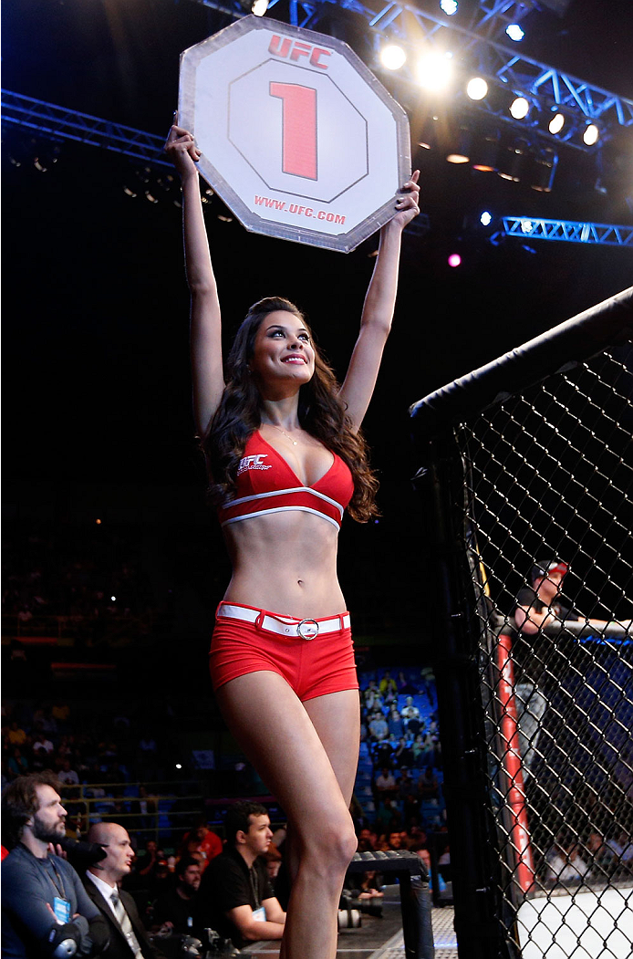 SAO PAULO, BRAZIL - MAY 31: UFC Octagon Girl Camila Rodrigues de Oliveira introduces a round during the UFC Fight Night event at the Ginasio do Ibirapuera on May 31, 2014 in Sao Paulo, Brazil. (Photo by Josh Hedges/Zuffa LLC/Zuffa LLC via Getty Images)