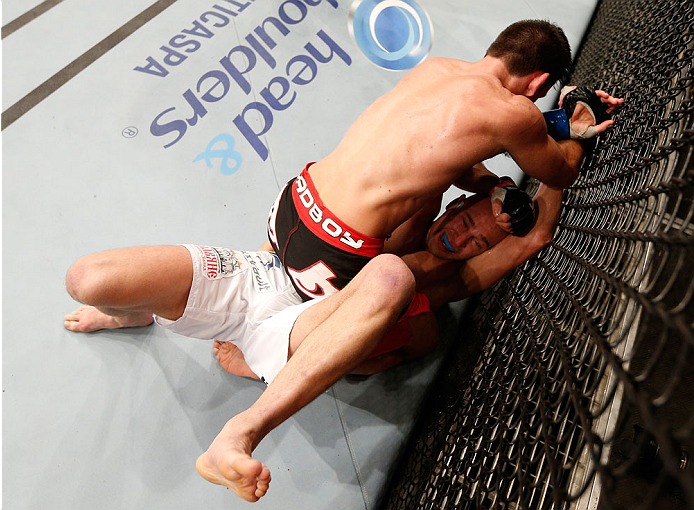 SAO PAULO, BRAZIL - MAY 31: Demian Maia (top) punches Alexander Yakovlev in their welterweight fight during the UFC Fight Night event at the Ginasio do Ibirapuera on May 31, 2014 in Sao Paulo, Brazil. (Photo by Josh Hedges/Zuffa LLC/Zuffa LLC via Getty Images)