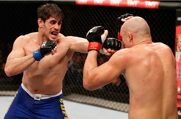 SAO PAULO, BRAZIL - MAY 31:  (L-R) Antonio Carlos Junior punches Vitor Miranda in their heavyweight fight during the UFC Fight Night event at the Ginasio do Ibirapuera on May 31, 2014 in Sao Paulo, Brazil. (Photo by Josh Hedges/Zuffa LLC/Zuffa LLC via Getty Images)