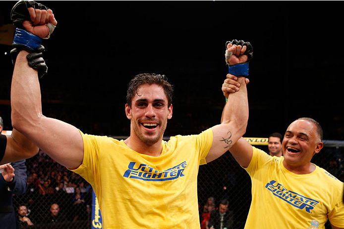 SAO PAULO, BRAZIL - MAY 31:  Antonio Carlos Junior celebrates after his unanimous decision victory over Vitor Miranda in their heavyweight fight during the UFC Fight Night event at the Ginasio do Ibirapuera on May 31, 2014 in Sao Paulo, Brazil. (Photo by Josh Hedges/Zuffa LLC/Zuffa LLC via Getty Images)