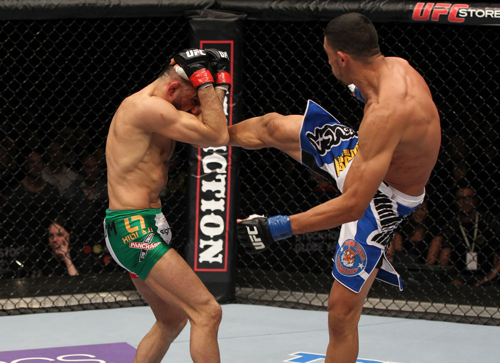 STOCKHOLM, SWEDEN - APRIL 14:  (R-L) Yoislandy Izquierdo kicks Reza Madadi during their lightweight bout at the UFC on Fuel TV event at Ericsson Globe on April 14, 2012 in Stockholm, Sweden.  (Photo by Josh Hedges/Zuffa LLC/Zuffa LLC via Getty Images)