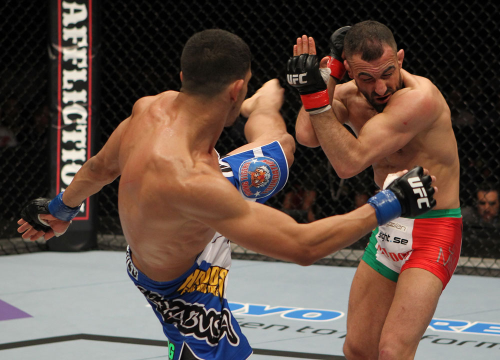 STOCKHOLM, SWEDEN - APRIL 14:  (L-R) Yoislandy Izquierdo kicks Reza Madadi during their lightweight bout at the UFC on Fuel TV event at Ericsson Globe on April 14, 2012 in Stockholm, Sweden.  (Photo by Josh Hedges/Zuffa LLC/Zuffa LLC via Getty Images)