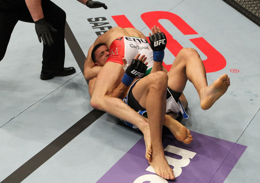 STOCKHOLM, SWEDEN - APRIL 14:  (R-L) Reza Madadi secures a guillotine choke submission against Yoislandy Izquierdo during their lightweight bout at the UFC on Fuel TV event at Ericsson Globe on April 14, 2012 in Stockholm, Sweden.  (Photo by Josh Hedges/Zuffa LLC/Zuffa LLC via Getty Images)