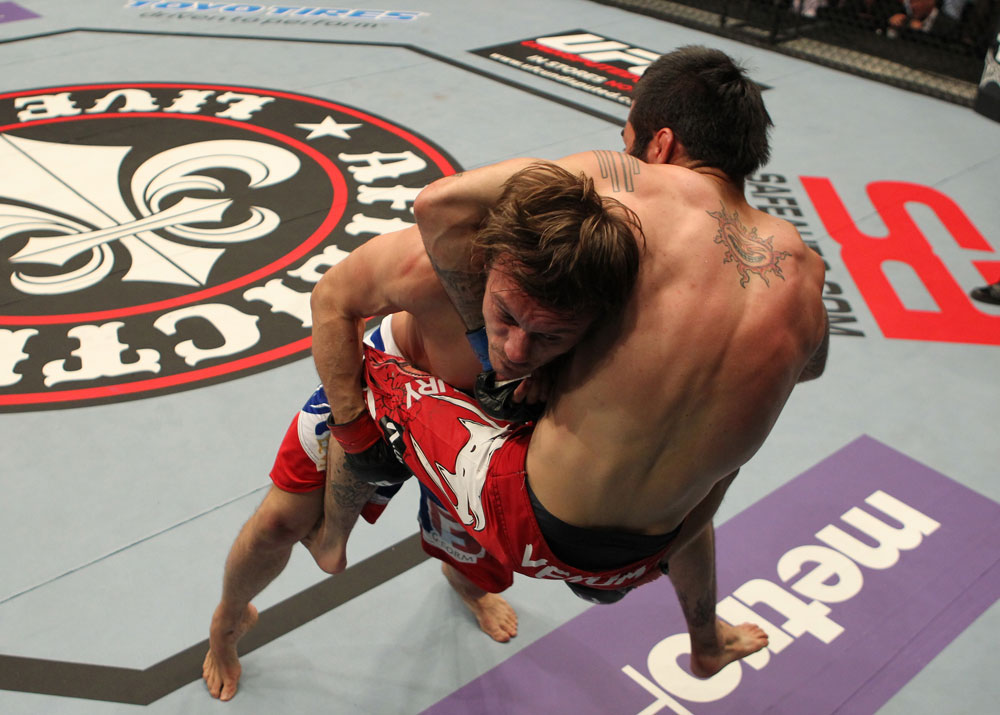 STOCKHOLM, SWEDEN - APRIL 14:  (L-R) Brad Pickett takes down Damacio Page during their bantamweight bout at the UFC on Fuel TV event at Ericsson Globe on April 14, 2012 in Stockholm, Sweden.  (Photo by Josh Hedges/Zuffa LLC/Zuffa LLC via Getty Images)