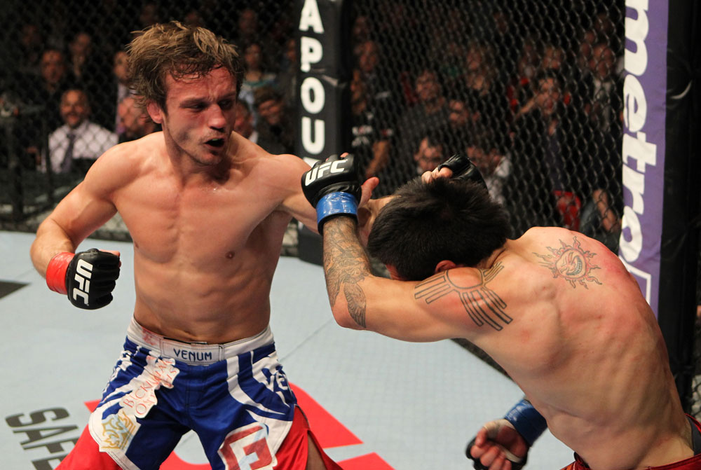 STOCKHOLM, SWEDEN - APRIL 14:  (L-R) Brad Pickett punches Damacio Page during their bantamweight bout at the UFC on Fuel TV event at Ericsson Globe on April 14, 2012 in Stockholm, Sweden.  (Photo by Josh Hedges/Zuffa LLC/Zuffa LLC via Getty Images)