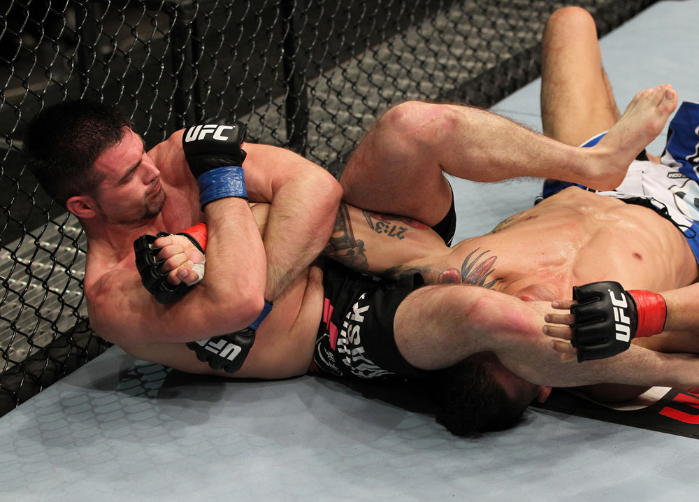 STOCKHOLM, SWEDEN - APRIL 14:  (L-R) John Maguire secures an arm bar submission against Damarques Johnson during their welterweight bout at the UFC on Fuel TV event at Ericsson Globe on April 14, 2012 in Stockholm, Sweden.  (Photo by Josh Hedges/Zuffa LLC/Zuffa LLC via Getty Images)