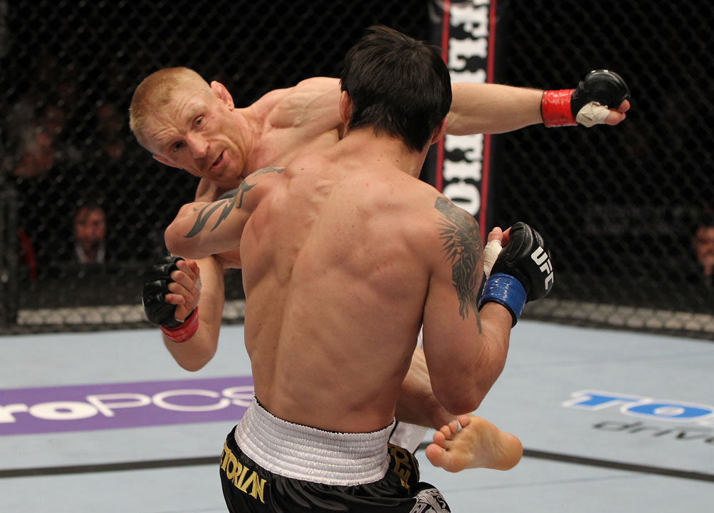 STOCKHOLM, SWEDEN - APRIL 14:  (L-R) Dennis Siver kicks Diego Nunes during their featherweight bout at the UFC on Fuel TV event at Ericsson Globe on April 14, 2012 in Stockholm, Sweden.  (Photo by Josh Hedges/Zuffa LLC/Zuffa LLC via Getty Images)
