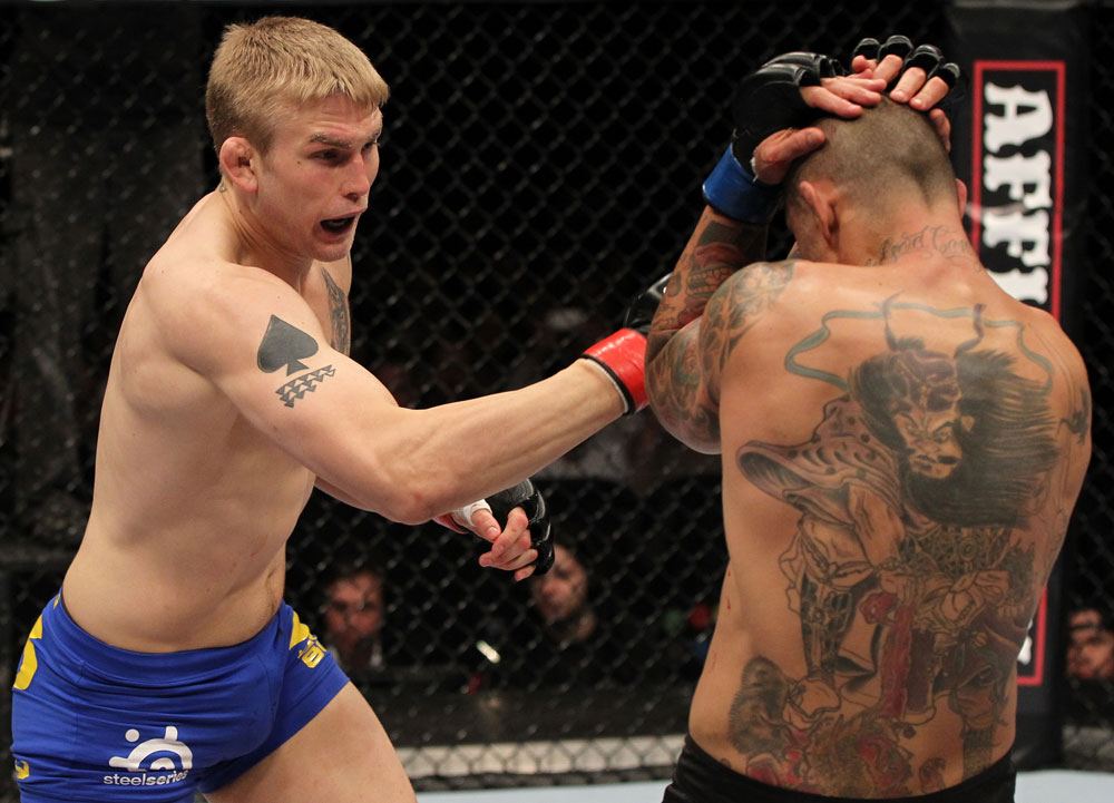 STOCKHOLM, SWEDEN - APRIL 14:  (L-R) Alexander Gustafsson punches Thiago Silva during their light heavyweight bout at the UFC on Fuel TV event at Ericsson Globe on April 14, 2012 in Stockholm, Sweden.  (Photo by Josh Hedges/Zuffa LLC/Zuffa LLC via Getty Images)
