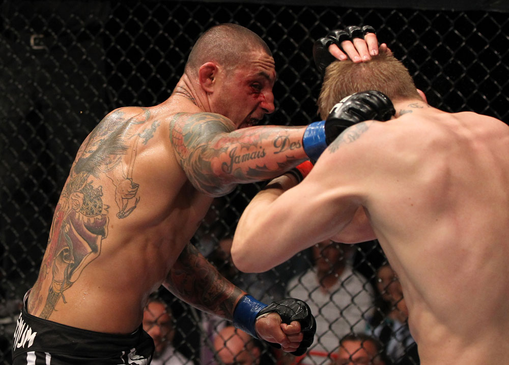 STOCKHOLM, SWEDEN - APRIL 14:  (L-R) Thiago Silva punches Alexander Gustafsson during their light heavyweight bout at the UFC on Fuel TV event at Ericsson Globe on April 14, 2012 in Stockholm, Sweden.  (Photo by Josh Hedges/Zuffa LLC/Zuffa LLC via Getty Images)