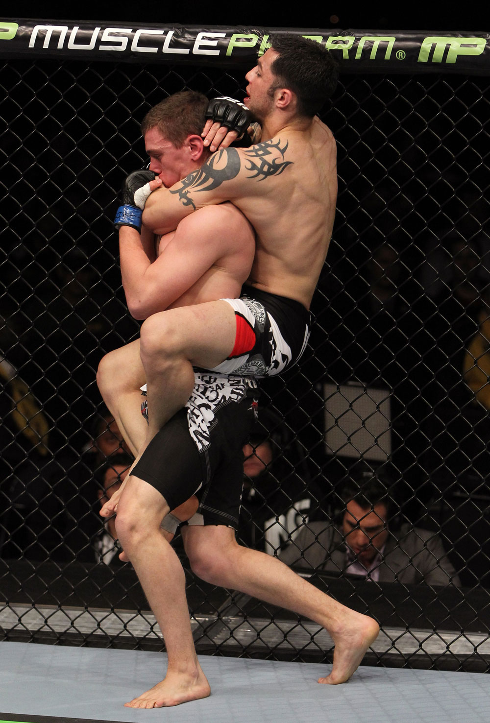 NASHVILLE, TN - JANUARY 20:  (R-L) Daniel Pineda secures a rear choke submission to defeat Pat Schilling during the UFC on FX event at Bridgestone Arena on January 20, 2012 in Nashville, Tennessee.  (Photo by Josh Hedges/Zuffa LLC/Zuffa LLC via Getty Images)