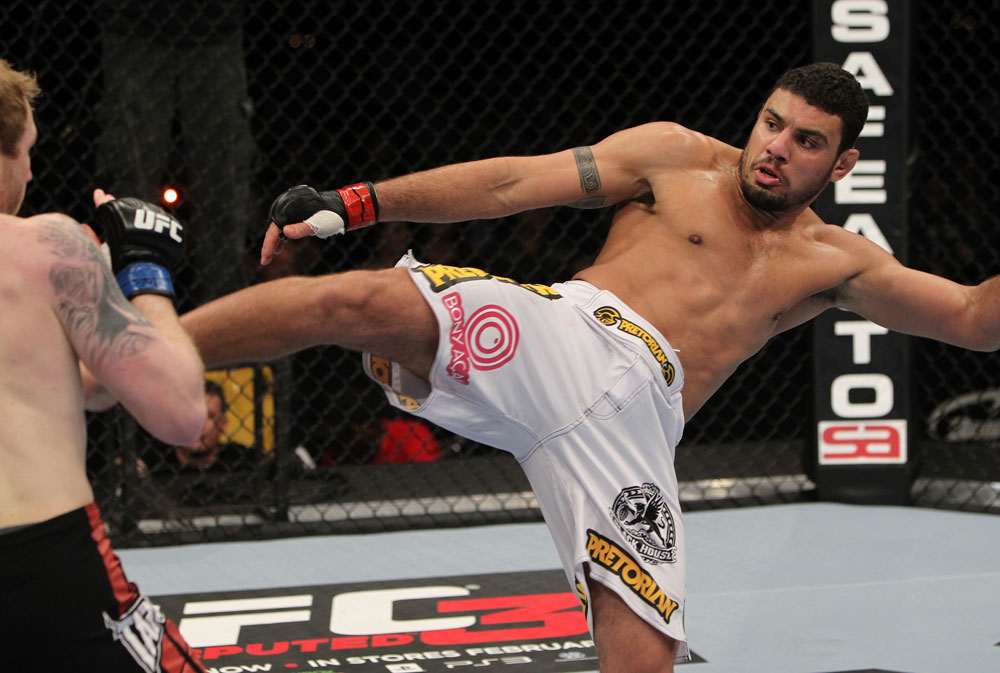 NASHVILLE, TN - JANUARY 20:  (R-L) Fabricio Camoes kicks Tommy Hayden during the UFC on FX event at Bridgestone Arena on January 20, 2012 in Nashville, Tennessee.  (Photo by Josh Hedges/Zuffa LLC/Zuffa LLC via Getty Images)