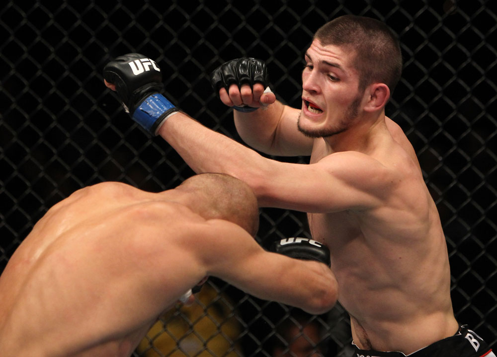 NASHVILLE, TN - JANUARY 20:  (R-L) Khabib Nurmagomedov punches Kamal Shalorus during the UFC on FX event at Bridgestone Arena on January 20, 2012 in Nashville, Tennessee.  (Photo by Josh Hedges/Zuffa LLC/Zuffa LLC via Getty Images)