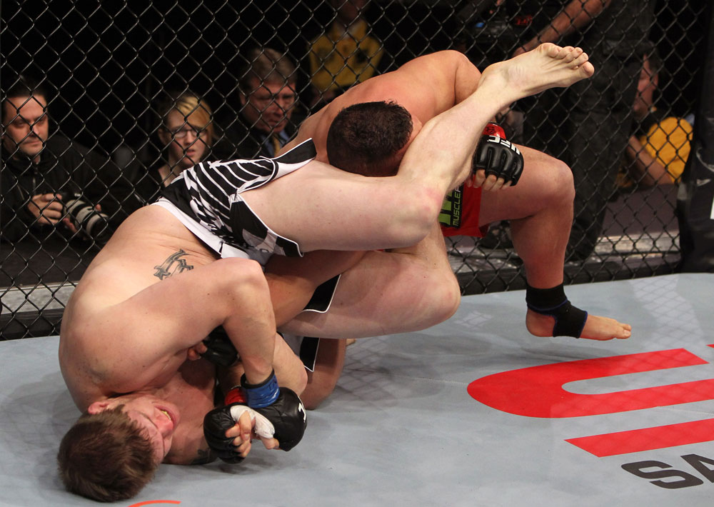 NASHVILLE, TN - JANUARY 20:  (L-R) Christian Morecraft attempts an arm bar submission against Pat Barry during the UFC on FX event at Bridgestone Arena on January 20, 2012 in Nashville, Tennessee.  (Photo by Josh Hedges/Zuffa LLC/Zuffa LLC via Getty Images)