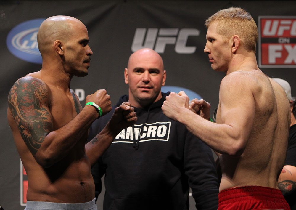 NASHVILLE, TN - JANUARY 19:  (L-R) Opponents Jorge Rivera and Eric Schafer face off after weighing in during the UFC on FX official weigh in at Bridgestone Arena on January 19, 2012 in Nashville, Tennessee.  (Photo by Josh Hedges/Zuffa LLC/Zuffa LLC via Getty Images)