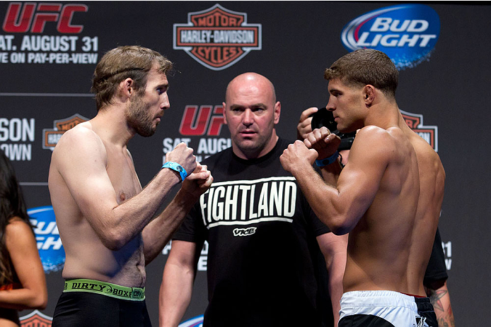 MILWAUKEE, WI - AUGUST 30:  (L-R) Ryan Couture and Al Iaquinta face off during the UFC 164 weigh-in inside the BMO Harris Bradley Center on August 30, 2013 in Milwaukee, Wisconsin. (Photo by Ed Mulholland/Zuffa LLC/Zuffa LLC via Getty Images) *** Local Caption *** Ryan Couture; Al Iaquinta