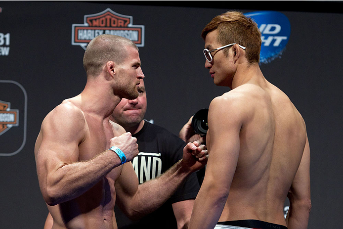 MILWAUKEE, WI - AUGUST 30:  (L-R) Pascal Krauss and Hyun Gyu Lim face off during the UFC 164 weigh-in inside the BMO Harris Bradley Center on August 30, 2013 in Milwaukee, Wisconsin. (Photo by Ed Mulholland/Zuffa LLC/Zuffa LLC via Getty Images) *** Local Caption *** Pascal Krauss; Hyun Gyu Lim