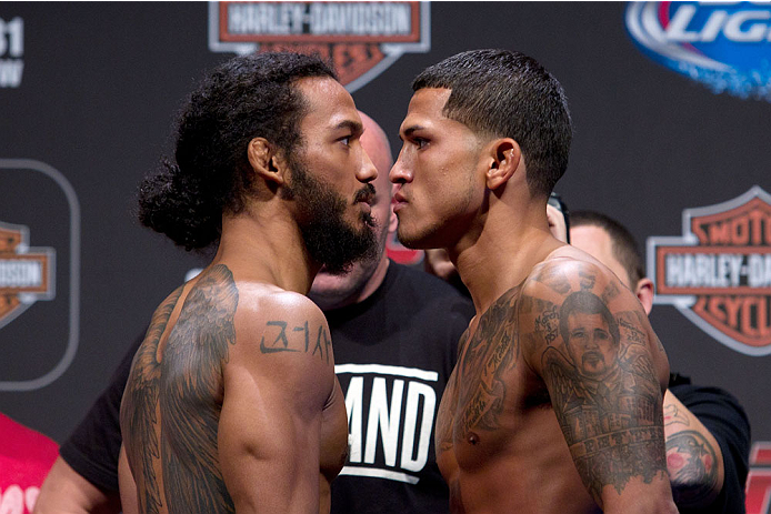MILWAUKEE, WI - AUGUST 30:  (L-R) Benson Henderson squares off against Anthony Pettis during the UFC 164 weigh-in inside the BMO Harris Bradley Center on August 30, 2013 in Milwaukee, Wisconsin. (Photo by Ed Mulholland/Zuffa LLC/Zuffa LLC via Getty Images) *** Local Caption *** Benson Henderson; Anthony Pettis
