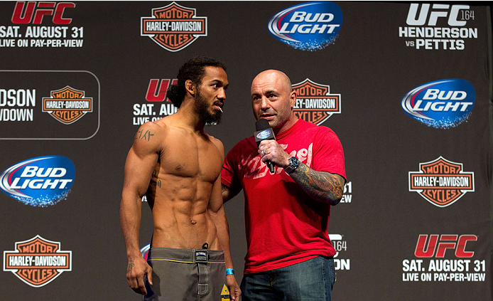 MILWAUKEE, WI - AUGUST 30:  Benson Henderson (L) is interviewed by Joe Rogan (R) during the UFC 164 weigh-in inside the BMO Harris Bradley Center on August 30, 2013 in Milwaukee, Wisconsin. (Photo by Ed Mulholland/Zuffa LLC/Zuffa LLC via Getty Images) *** Local Caption *** Joe Rogan; Benson Henderson