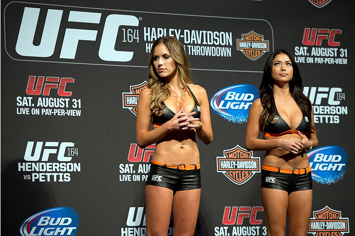 MILWAUKEE, WI - AUGUST 30:  UFC Octagon Girls Brittney Palmer (L) and Arianny Celeste stand on stage during the UFC weigh-in inside the BMO Harris Bradley Center on August 30, 2013 in Milwaukee, Wisconsin. (Photo by Jeff Bottari/Zuffa LLC/Zuffa LLC via Getty Images) *** Local Caption *** Brittney Palmer; Arianny Celeste