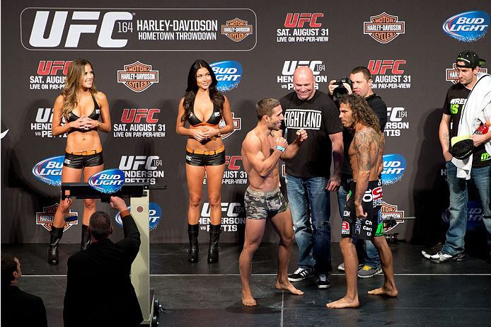 MILWAUKEE, WI - AUGUST 30:  (L-R) Chad Mendes and Clay Guida face off during the UFC weigh-in inside the BMO Harris Bradley Center on August 30, 2013 in Milwaukee, Wisconsin. (Photo by Jeff Bottari/Zuffa LLC/Zuffa LLC via Getty Images) *** Local Caption *** Chad Mendes; Clay Guida