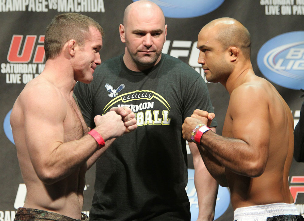 Welterweight opponents Matt Hughes (L) and BJ Penn (R) face off as UFC President Dana White looks on at the UFC 123 weigh-in at the Palace of Auburn Hills on November 19, 2010 in Auburn Hills, Michigan.  (Photo by Josh Hedges/Zuffa LLC/Zuffa LLC via Getty Images)