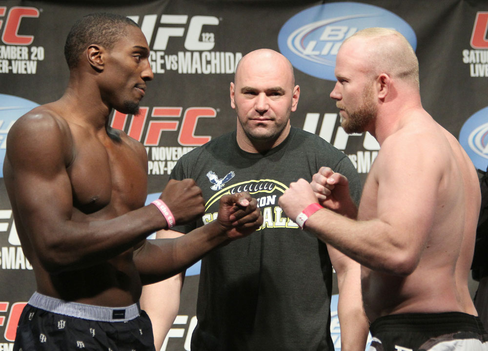 Light Heavyweight opponents Phil Davis (L) and Tim Boetsch (R) face off as UFC President Dana White looks on at the UFC 123 weigh-in at the Palace of Auburn Hills on November 19, 2010 in Auburn Hills, Michigan.  (Photo by Josh Hedges/Zuffa LLC/Zuffa LLC via Getty Images)