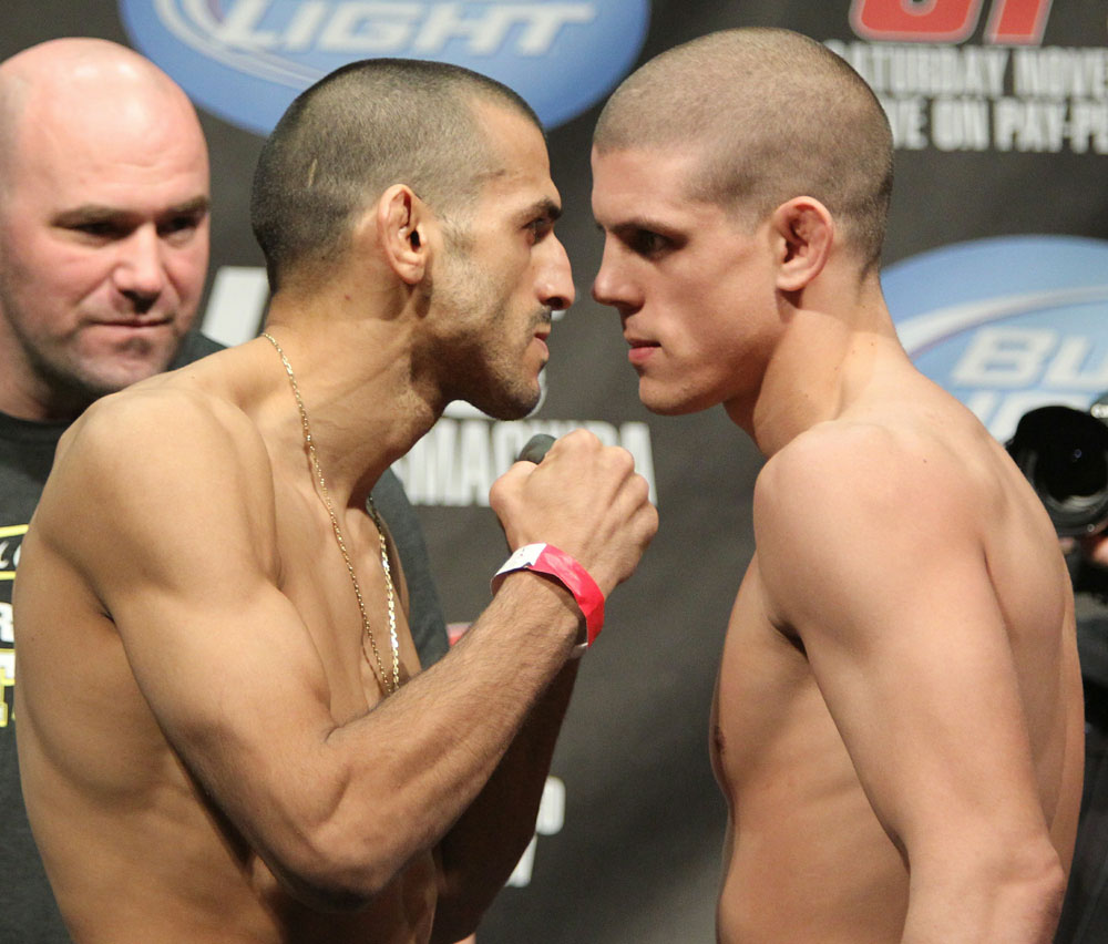 Lightweight opponents George Sotiropoulos (L) and Joe Lauzon (R) face off as UFC President Dana White looks on at the UFC 123 weigh-in at the Palace of Auburn Hills on November 19, 2010 in Auburn Hills, Michigan.  (Photo by Josh Hedges/Zuffa LLC/Zuffa LLC via Getty Images)