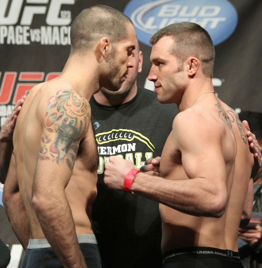 Welterweight opponents Matt Brown (L) and Brian Foster (R) face off at the UFC 123 weigh-in at the Palace of Auburn Hills on November 19, 2010 in Auburn Hills, Michigan.  (Photo by Josh Hedges/Zuffa LLC/Zuffa LLC via Getty Images)