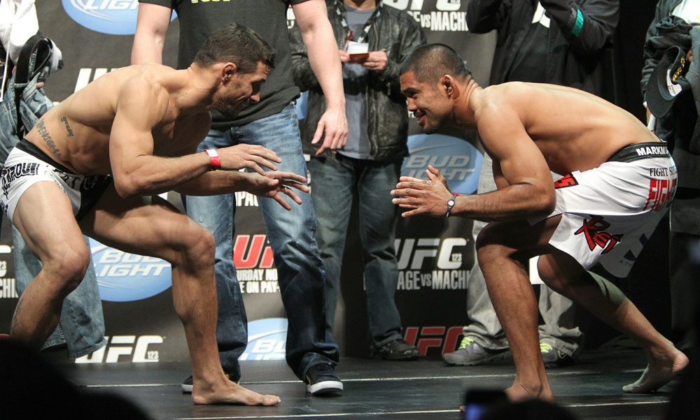 Middleweight opponents Aaron Simpson (L) and Mark Munoz (R) face off at the UFC 123 weigh-in at the Palace of Auburn Hills on November 19, 2010 in Auburn Hills, Michigan.  (Photo by Josh Hedges/Zuffa LLC/Zuffa LLC via Getty Images)