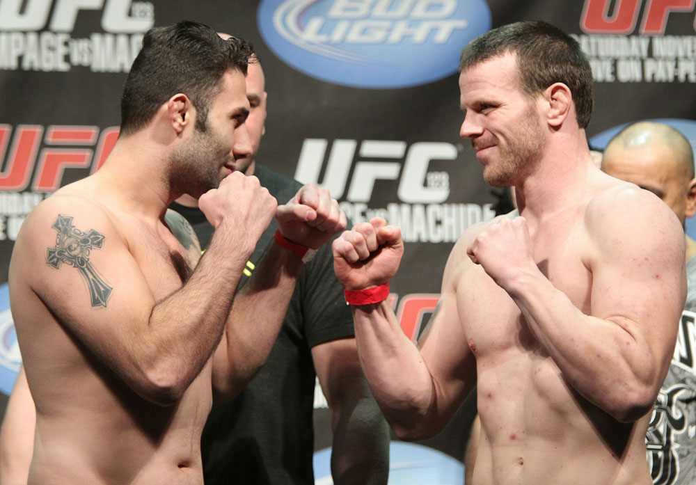 Welterweight opponents Karo Parisyan (L) and Dennis Hallman (R) face off at the UFC 123 weigh-in at the Palace of Auburn Hills on November 19, 2010 in Auburn Hills, Michigan.  (Photo by Josh Hedges/Zuffa LLC/Zuffa LLC via Getty Images)