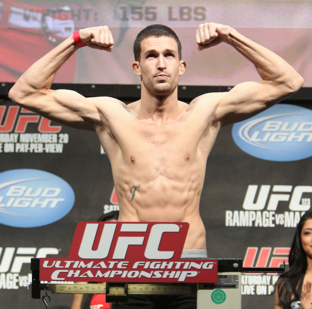TJ O&#39;Brien weighs in at 155 lbs at the UFC 123 weigh-in at the Palace of Auburn Hills on November 19, 2010 in Auburn Hills, Michigan.  (Photo by Josh Hedges/Zuffa LLC/Zuffa LLC via Getty Images)