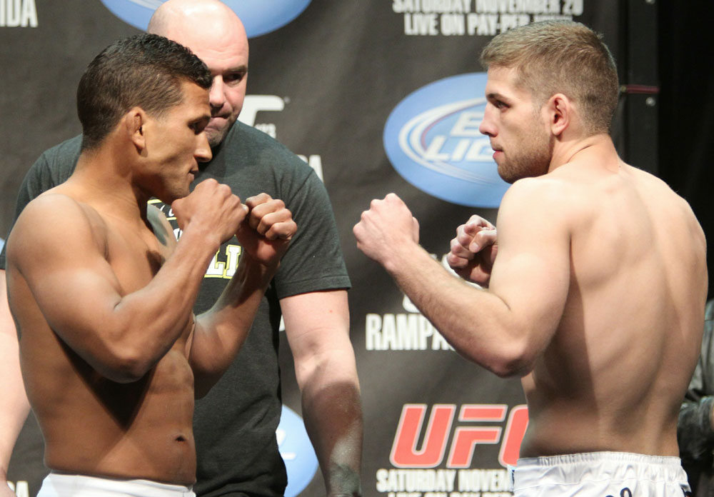 Lightweight opponents Paul Kelly (L) and TJ O'Brien (R) face off at the UFC 123 weigh-in at the Palace of Auburn Hills on November 19, 2010 in Auburn Hills, Michigan.  (Photo by Josh Hedges/Zuffa LLC/Zuffa LLC via Getty Images)