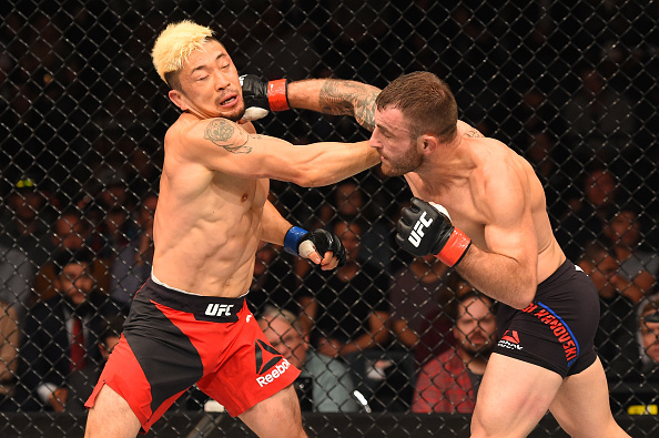 Alexander Volkanovski punches Mizuto Hirota during their featherweight bout at Fight Night Auckland