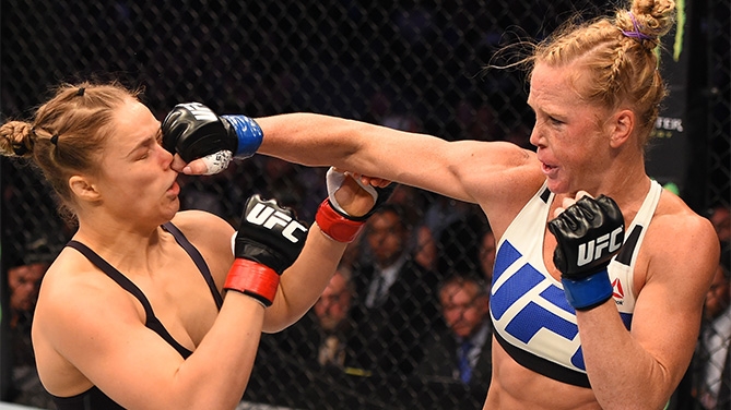 (R-L) Holly Holm of the United States punches Ronda Rousey of the United States in their UFC women's bantamweight championship bout during the UFC 193 event at Etihad Stadium on November 15, 2015 in Melbourne, Australia. (Photo by Josh Hedges/Zuffa LLC)