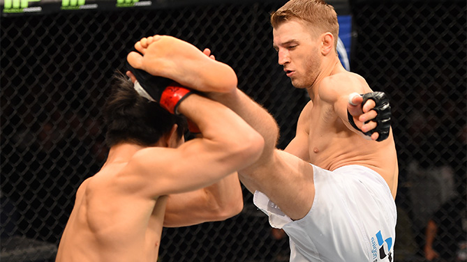 (R-L) Daniel Hooker kicks Hatsu Hioki in their featherweight bout during the UFC Fight Night event at the Adelaide Entertainment Centre on May 10, 2015 in Adelaide, Australia. (Photo by Josh Hedges/Zuffa LLC)