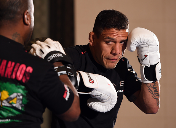 dos Anjos hitting mitts at Open Workouts