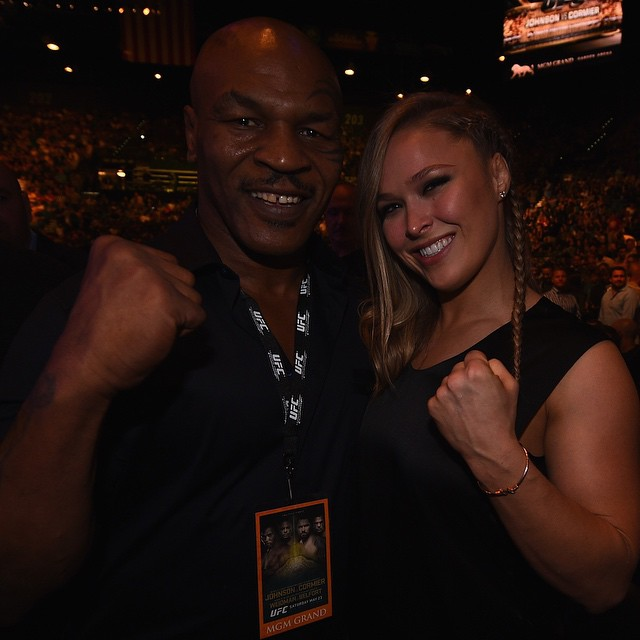 Former UFC women's bantamweight champion Ronda Rousey poses for a photo with former boxing heavyweight champion Mike Tyson at UFC 187.