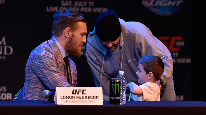 McGregor signs an autograph for a young fan