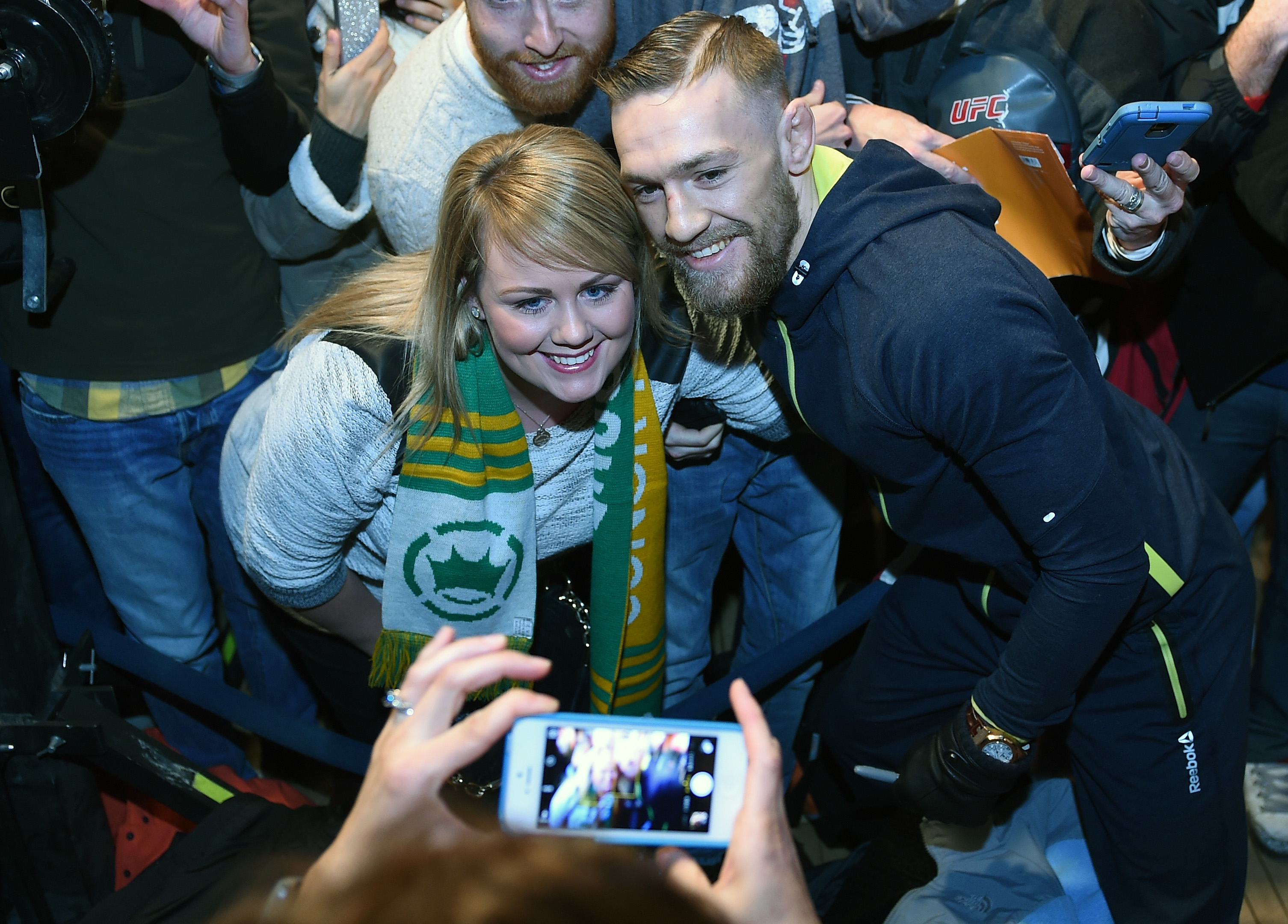 McGregor poses for pictures with fans.