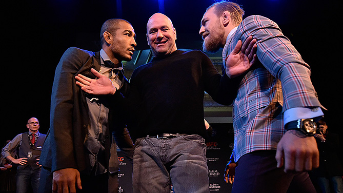 Aldo (left) is separated by Dana White (middle) from McGregor