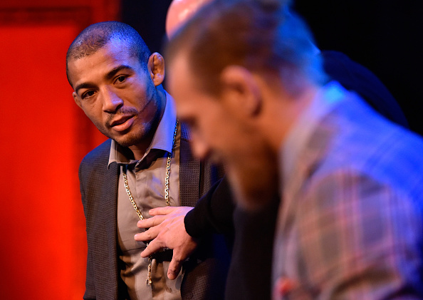 Aldo (left) looks at McGregor during staredown