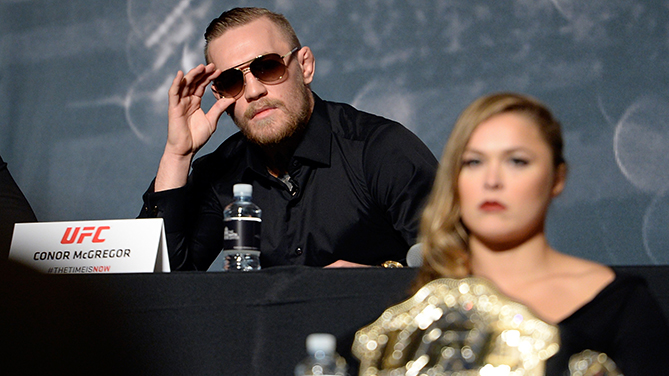 Conor McGregor (top) and Ronda Rousey