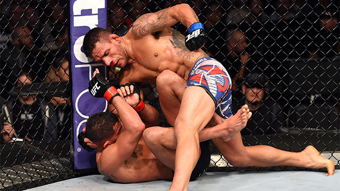 Rafael dos Anjos of Brazil controls the body of Anthony Pettis in their UFC lightweight championship bout during the UFC 185 event at the American Airlines Center on March 14, 2015 in Dallas, Texas. (Photo by Josh Hedges/Zuffa LLC)