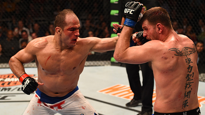 Dos Santos (left) throws left at Miocic