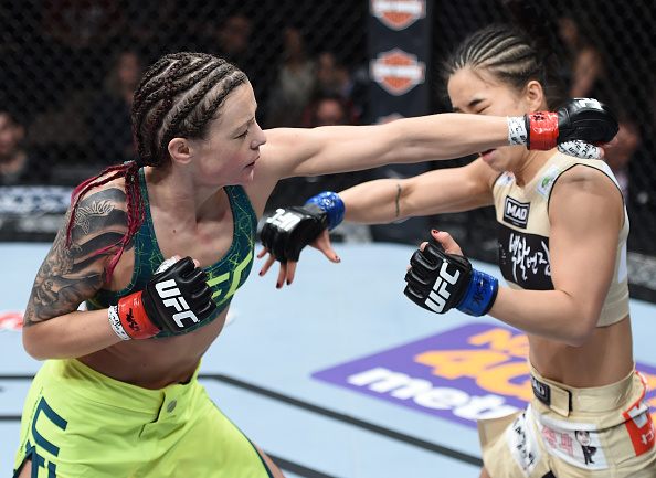 LAS VEGAS, NEVADA - DECEMBER 12: (L-R) Joanne Calderwood punches Seohee Ham in their strawweight fight during The Ultimate Fighter Finale event inside the Palms Casino Resort on December 12, 2014 in Las Vegas, Nevada. (Photo by Jeff Bottari/Zuffa LLC/Zuffa LLC via Getty Images)